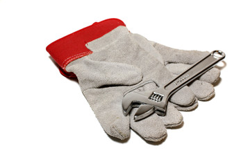 A pair of workmans gloves and a wrench