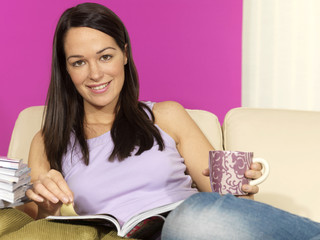 Young Woman Reading a Magazine. Model Released