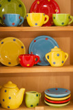 Cupboard with cheerful crockery poster