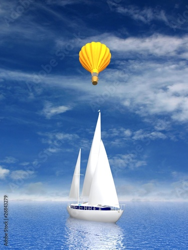 Sailing luxury yacht and flying balloon