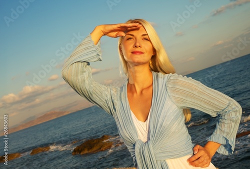 Beautiful woman near the sea