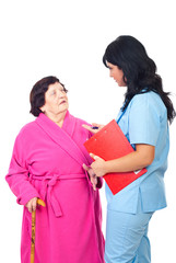 Doctor converse with elderly patient