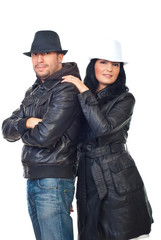 Beautiful couple of models in leather jackets