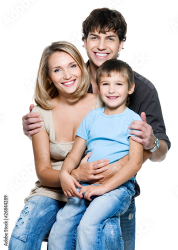 Happy young family with pretty child