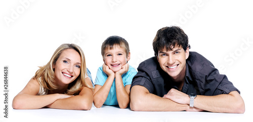 Happy young family with child lying on floor