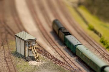 model train passing a signal box