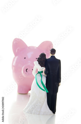 cake-topper wedding couple and piggy bank
