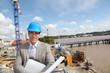 Businessman controlling site under construction