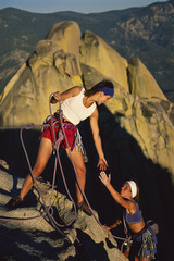 Female rock climbing team.