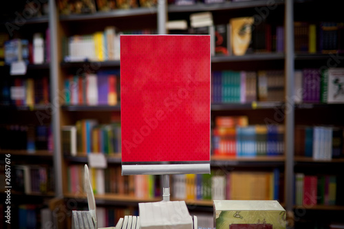 Red ad space in bookstore - many books in the background