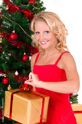 Young beautiful girl opening Christmas box