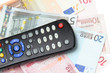 TV remote control on the euro banknotes