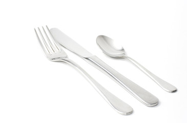 Fork, knife and teaspoon with white background.