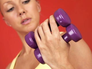 Young Woman Lifting Weights. Model Released