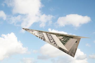 dollar paper plane in the sky