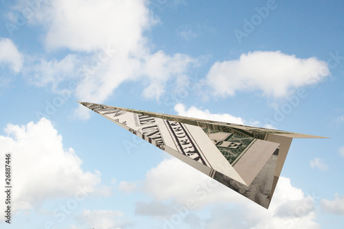 dollar paper plane in the sky
