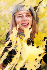 woman in autumn foliage