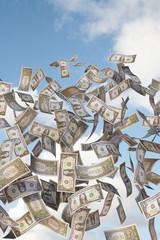 1 dollar bills flying in the sky