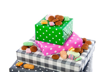 Dutch Sinterklaas gifts and candy gingernuts isolated on white b