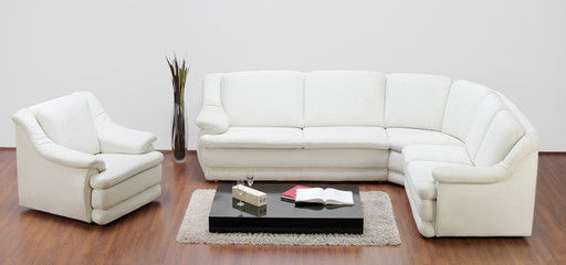 Studio shot of a white furniture, sofa and chair