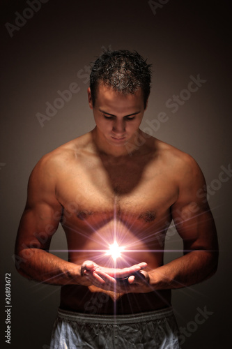 Muscular man holding a fire ball