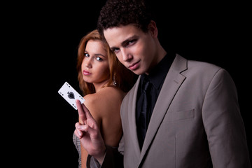 young couple, man holding a ace of spades