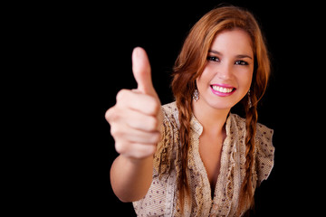 Young pretty women with thumb raised as a sign of success