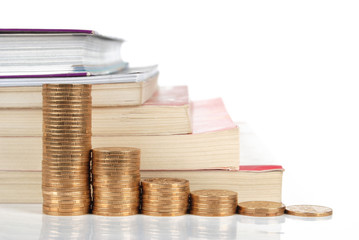 Books with coins on white background