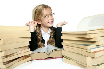 little student blond braided girl smiling with stacked books