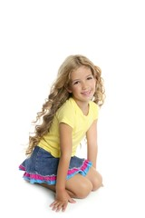 little blond girl smiling portrait on her knees