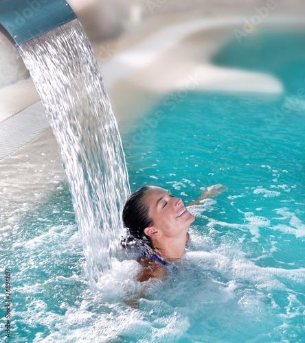 Leinwandbild Motiv spa hydrotherapy woman waterfall jet