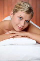 Closeup of beautiful woman on massage bed