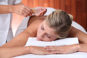Closeup of beautiful woman laying on a massage bed