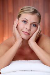 Closeup of beautiful woman on massage bed