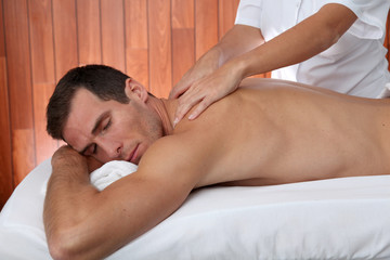 Man having a facial massage in spa center