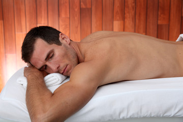 Man relaxing on a massage bed