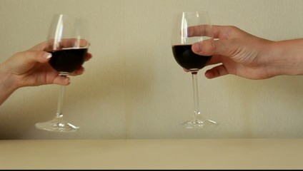 The clink of glasses of wine