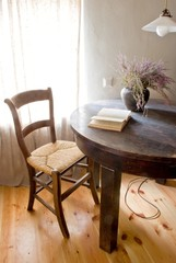 Retro rural room in farmhouse with table and book