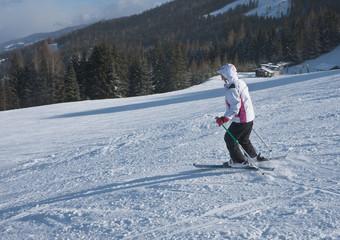 A woman is skiing at a ski resort