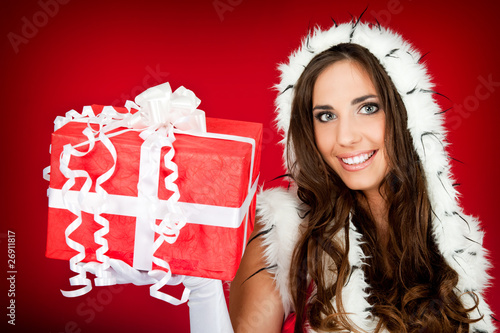 beautiful woman holding xmas present