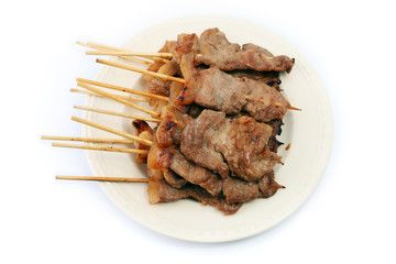 Roast Pork in a Stick on White Background