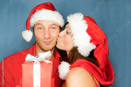 christmas couple portrait with gifts and presents