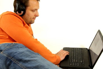 Man with headphones and laptop, isolated