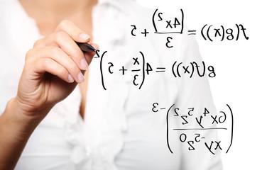 Toung teacher solving a mathematical equation