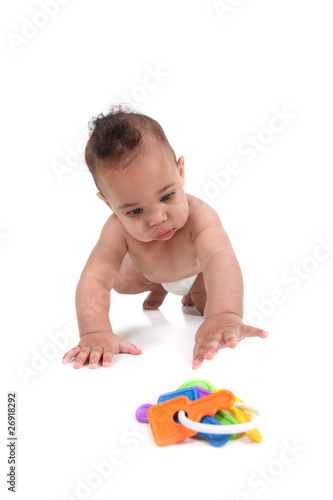 Infant little boy crawling towards the viewer