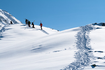 Skiers ascending on a mountain
