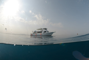 Fish eye view of a motor boat on a calm ocean