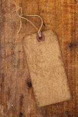 old paper tag with string on grunge wooden table