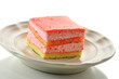 strawberry flavored layer cake on a plate