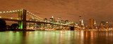 Fototapety Panorama of Manhattan and Brooklyn Bridge by night